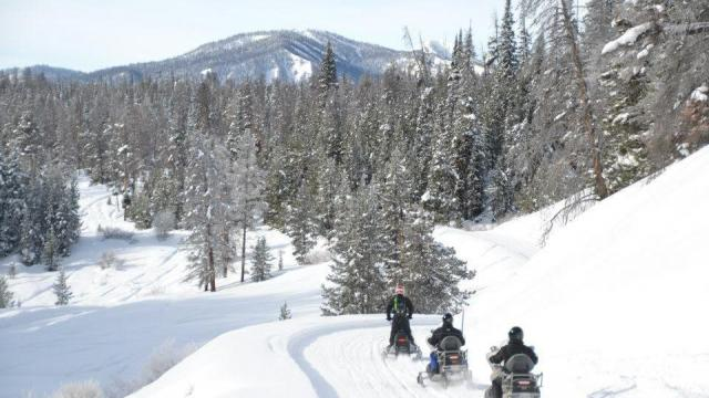 Winter snowmobile adventure in jackson hole for Best winter vacation deals